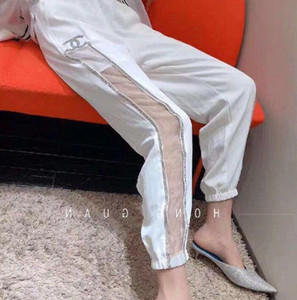 Été nouveau pantalon de forage chaud tempérament style pantalon décontracté des femmes de conception micro épissure transparent lâche et sarouel confortable