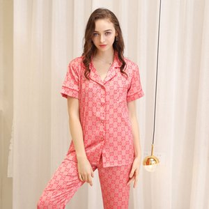 Luxury Высококачественная 2 шт костюм дизайнер Matching пижамы весной и осенью стиль мужской лед шелк короткий костюм с длинным рукавом пижамы женщин