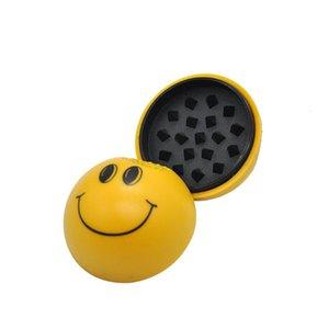 Moedor de fumo manual plástico da cara do sorriso com ímã