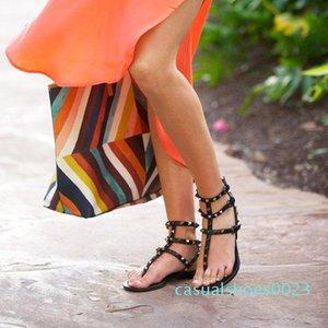 Venta-Zapatos Mujer caliente Color Remaches pinchos gladiador sandalias planas de piedras tachonado tirón c23 barato verano de la sandalia del tamaño grande de diseño para mujeres