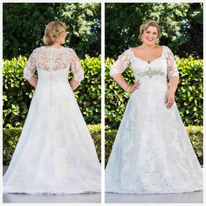 Plus Size Ligne Robes de Mariée avec demi-manches 2020 à encolure dégagée Sheer longue Princesse d'hiver Robes de mariée cristal Appliques