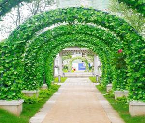 pianta artificiale rigogliosa edera foglie di vite di vite foglia verde piante salita artificiale per la decorazione di sposarsi