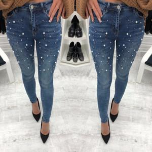 Jeans señoras del resorte nuevos europeos y americanos de las mujeres usar pantalones vaqueros de la moda de las señoras moldeadas vaqueros flacos de alto estiramiento de mezclilla con perlas pa