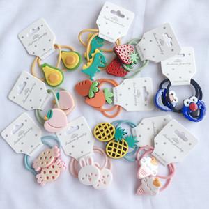 Corda 20pcs / Lot Coreia Crianças dos desenhos animados cabelo Acrílico alta Elastic Pouco Rubber menina banda para o bebê veste-se acima da cabeça do anel Cabelo Jóias Acessórios