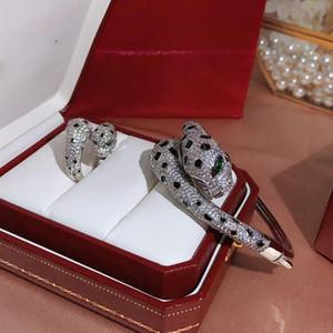 Высокое качество новый кубический цирконий двойной черный пятнистый леопард голова браслет 18K позолоченные браслеты и кольца партии ювелирные наборы для женщин