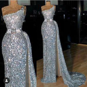 Afrikanische Silber-Nixe-Abschlussball-Kleider mit Pailletten einer Schulter Backless High Side Split-Partei-Kleid für besondere Anlässe Kleid Abendkleider