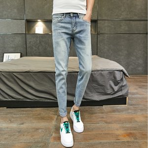 Nine-point jeans men's summer thin section men's slim feet wild light-colored 9 pants male Korean version of the trend