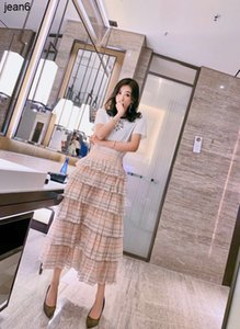 New 2020 fashion leisure goddess friend high waist thin cake skirt mini-Plaid half skirt 040505