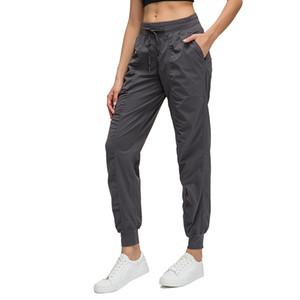 Ins nuovi pantaloni da yoga tascabile intrecciati allentati pantaloni allentati a gambe a gambe rapide sport elastico sportivo casual pantaloni donne autunno e inverno L-029