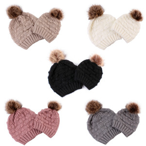 Bambino sveglio Bambino Cappelli bambino mamma calda inverno Crochet Knit Hat 2019 Marca Beanie pelliccia Butterfly Ball Caps Boy Girl Caps DHL
