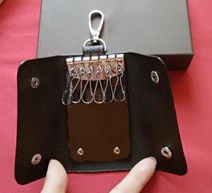 Famosa marca mujeres hombres marca 6 llavero titular de la tarjeta monederos de cuero genuino alta calidad envío gratis con caja A14