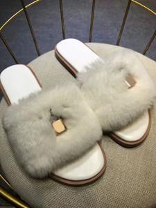 volver cinturón blanco de pelo de conejo negro de gama alta famosos zapatos de marca de moda de invierno 2019 contra la caída de zapatillas calientes de interior de los partidos zapatos de las mujeres perezosas