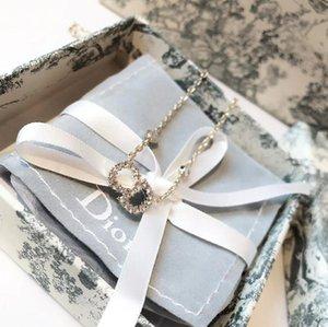 DIOR diseñador de joyería de hip hop collar de la mariposa del diseñador hacia fuera helado colgante para hombre 14k cadenas de oro letra inicial collares de perlas Q1
