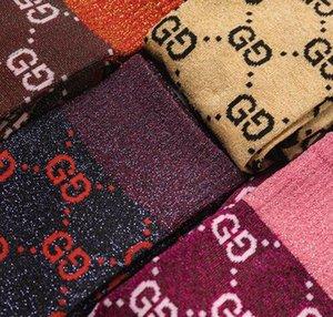 Uomini donne progettista calzini colpisce con forza l'autunno nuovo colore lettera caramelle mucchio mucchio calze femminili di moda multicolore calza di cotone selvaggio può essere miscelato