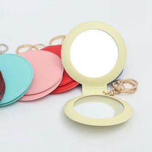 Pelle doppio lato Floding specchio PU Protable Pocket specchio per il trucco con gancio impermeabile di colore della caramella Specchi portachiavi HHA866