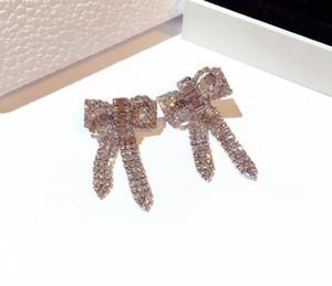 elmas ışıltılı Toptan stilin ins moda lüks tasarımcı süper kadın kızlar için sevimli güzel yay damızlık küpe zirkon