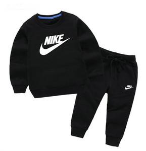 Promoción al por mayor barata Nuevo bebé caliente 2-7 años - niños y niñas Ropa deportiva tops + pantalones ropa infantil A001