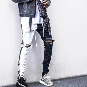 Il progettista del mens pantaloni Elegante High Street Mens del motociclista della matita dei pantaloni di primavera Holes ginocchio strappato Nero Bianco Patchwork Jean tousers
