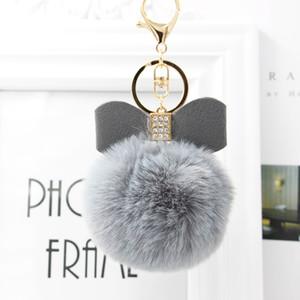 diamante farfalla calda di vendita bella Fluffy coniglio catena sfera della pelliccia chiave del coniglio Pompon artificiale pelliccia Keychain Car Donne Bag Portachiavi