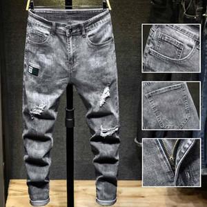 2020 Mens Spring Street Hiphop Jeans Agujeros Negro azul de la cremallera el diseñador Jean pantalones ocasionales flacos del dril de algodón Pantalones 1919
