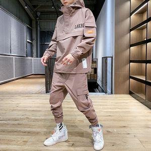 Хип-хоп Tracksuit Мужчины Карманный Сыпучие Черный Повседневная куртка Мужчины Длинные рукава Мужская одежда Уличная Набор Большой размер B60