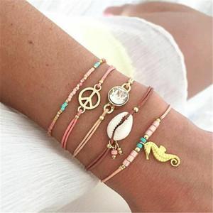 ALYXUY 5Pcs / Set Boho Mehrschichtige Hippocampus Shell-Korn-Armband für Frauen-justierbares Armband-gesetzte Art und Weise Beach Party Schmuck
