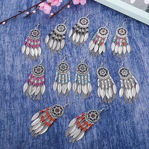 Round flower-shaped diamond earrings female long section European and American retro ethnic style rice beads leaf earrings