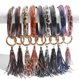 Frauen Quasten Armbänder PU-Leder-Verpackungs-Schlüsselring-Leopard-Blumen-Druck Keychain Armband Sonnenblume Drip Öl-Armband-Armband-Anhänger A101702