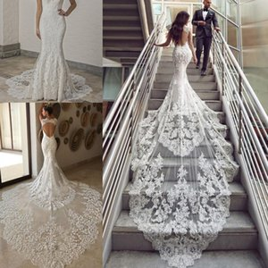 Luxo frisada Vestidos de noiva sereia 2020 Querida Cap Sleeve Backless Long Tail Botão Applique Lace Voltar Noiva Vestidos