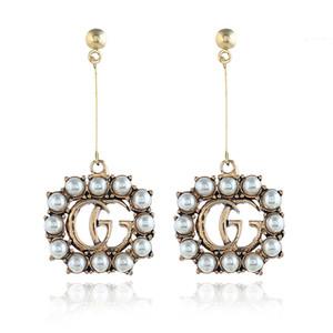 Orecchini di lusso in stile retrò per donna Orecchino da donna decorato con perle e accessori per orecchie con stampa lunga nappa