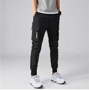 Solid Pants Mens di colore Cargo coulisse tasca più di lavoro Pantalone elastico in vita Pantaloni di modo maschio abbigliamento