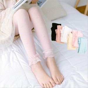 Medias caramelo chicas polainas del bebé del cordón del hueco del color del estiramiento de los pantalones de los niños transpirable Panti Thin mediados de cintura de los pantalones de moda caliente AYP547