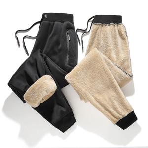 Mens de la marca de invierno pantalones casuales pantalones de lana de cordero elástico estiramiento de la cintura Harem Plus Tamaños 4XL caliente grueso Pantalones Negro Gris