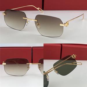 Meilleures ventes de lunettes de soleil de gros 0113 design d'avant-garde ultra-léger irrégulier rétro UV400 lumière sans cadre lentilles colorées lunettes décoratives
