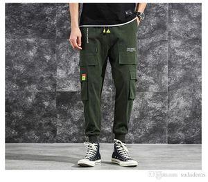 Sólido de la manera con la Grande bolsillo cargo pantalones informales con cordón elástico Pantalones Abajo Diseñador HipPop Homme Pantalon