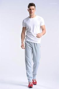 Pantalon coréenne Homme Sport loose droite longue Sweatpants Mode Homme Automne Pantalon Designer Drawstring Mens solide