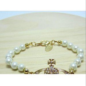 Best selling fashion ladies boutique planet inlaid rhinestone pearl small Saturn bracelet alloy creative handmade jewelry accessories1