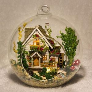 G015 Casa de muñecas de bricolaje Miniatura Mini Kits de construcción modelo de bola de cristal Casa de muñecas en miniatura Regalo de juguete Forest Villa Envío gratis Y19070503