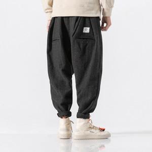 Nuevos hombres de invierno de lana gruesa cálida a cuadros ocasionales Harem Pant Pantalones de moda sueltos masculinos Streetwear Hip Hop Pant Plus Size M-5XL