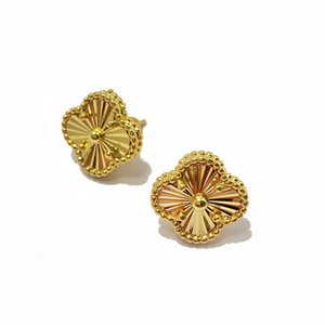 exquisite copper plated glossy fashion designer jewelry women earrings flower earings carved earrings stud earrings des boucles d'oreilles