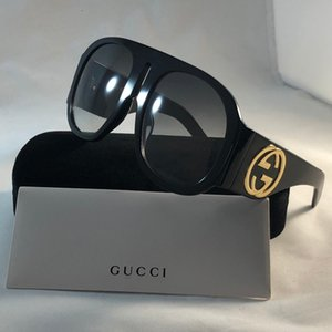 Diseñador de lujo 0512 hombres y mujeres gafas de sol de la marca de moda oval Sun marco de los vidrios de protección UV Revestimiento de la lente sin marco plateado con la caja Caso