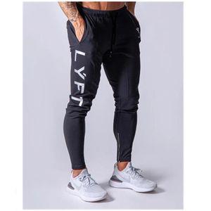 Новый бег брюки мужчины Спорт тренировочные брюки тренажерный зал бег брюки мужчины бегунов хлопок уменьшают подходящие брюки Trackpants Бодибилдинг для брюк