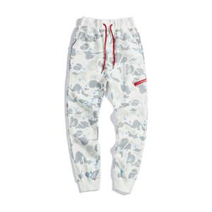 Venta al por mayor nuevos hombres mujeres Starry Camo pantalones casuales de los hombres negro blanco Camo luminoso Hip Hop pantalones de chándal pantalones