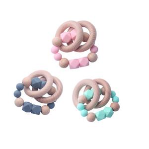 Zwei natürliche Holz Ring Bead Beißring für Baby Health Care Zubehör Infant Finger Übung Spielzeug bunte Silikon Perlen Schnuller