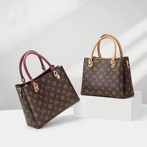 The latest comfortable and decorative printed bag for ladies, with neat sewing lines, can be carried across one shoulder.