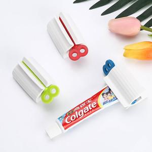 Manual de rotação do dentífrico espremedor de plástico ABS Rolar Tubo Dispenser Novidade acessórios do banheiro práticas 3 cores 2 2QR E1