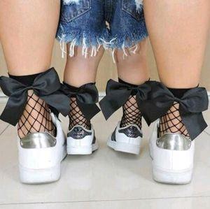 fita INS Meninas Arcos meias ocas 2020 Outono Nova ciranças buraco malha meias estilo britânico crianças tricô meias mãe e filha meia A3343
