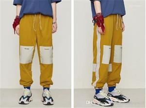 Pantaloni stampati Sport Mens allentato Panelled Esecuzione Pantaloni Moda Sport pantaloni con coulisse Mens Lettera Designer