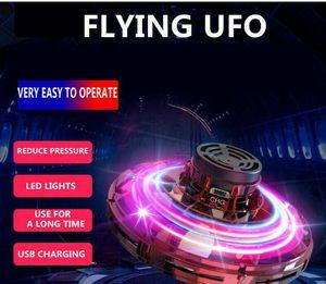 comprar 2 unidades Flynova UFO Gyro mosca Spinner Juguete antiestrés mano del mini Fly Gyro rotador con iluminación LED dedo Spinner Rotary