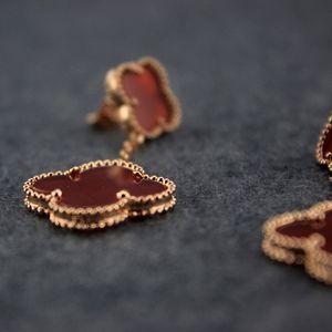 Clover Troddelohrring Weiblich Vier-Blatt-Bolzen Frauen-Partei-Rosen-goldene Ohrringe Dropshipping